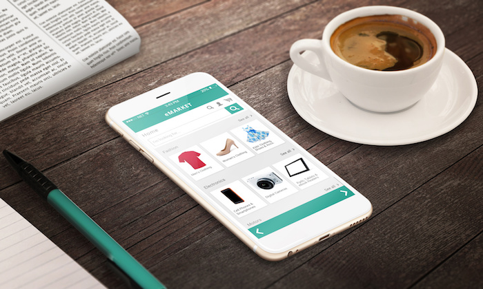 on line shopping with smart phone on wooden table relax time with coffee newspaper pencil growing marketing concept